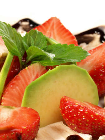 Closeup of strawberries and avocado with mushrooms photo