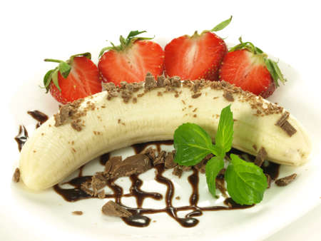 chocolate mint: Peeled banana on a plate with strawberries, chocolate and mint Stock Photo