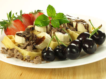 chocolate mint: Waffles with fresh fruits and chocolate topping Stock Photo