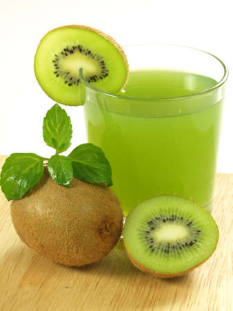 fruit juices: Glass of fresh green cocktail with kiwi fruits.