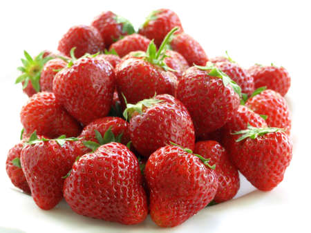 Heap of ripe, fresh and juicy strawberries photo