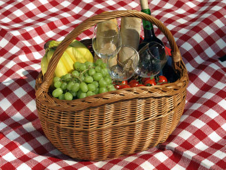 Wine, glasses, fruits, and baguettes for picnic photo