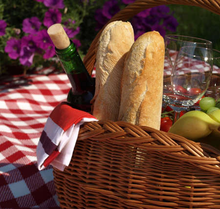 Basket with food and wine for picnic photo