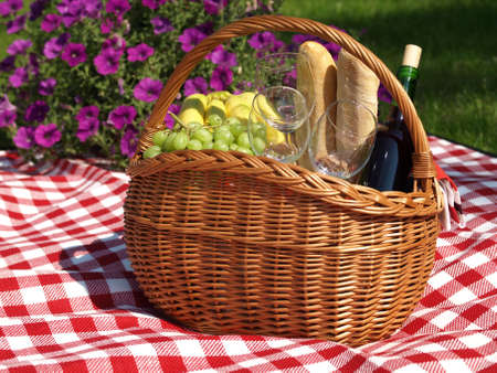 Summer picnic with wine, baguettes and fruits  photo