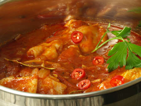 Chicken with chilli boiled in the pot photo