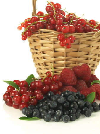 Wicker basket full of summer fruits, isolated background Stock Photo - 14368838