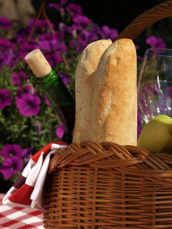 Baguettes and wine for the outdoors picnic photo