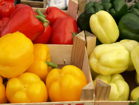 Red yellow and green bell peppers, closeup photo