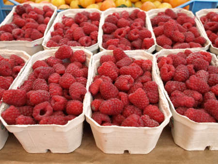 stall: Boxes with fresh juicy raspberries for sale
