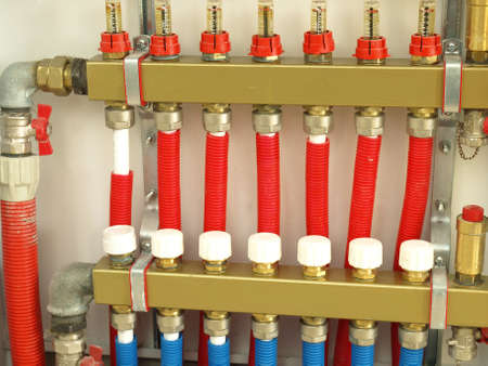 Construction of a house heating system, valves photo