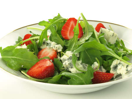 spinach salad: Spinach with blue lettuce leaves and halves of strawberry