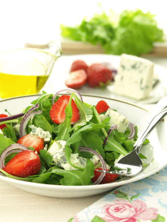 Light salad with strawberries and gorgonzola cheese photo