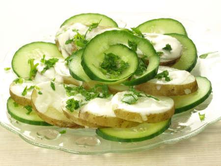 jacked: Fresh slices of cucumber and potato with yogurt