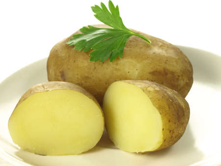 unpeeled: Closeup of two jacket potatoes on isolated background