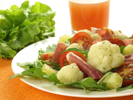 Vegetables, parma ham and glass of fresh juice Stock Photo - 14464421