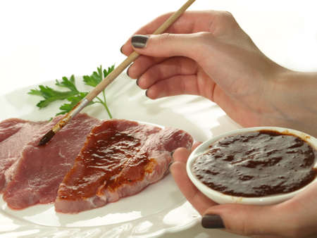 marinade: Marinating slices of beef with marinade for barbecue Stock Photo