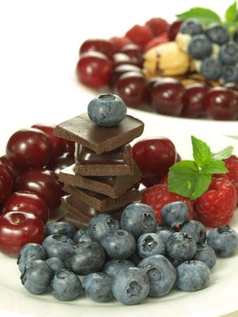harmful: Sweetness from healthy fruits and harmful chocolate Stock Photo