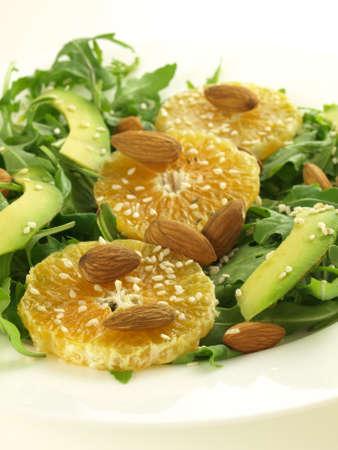 Salad with almonds, sesame and arugula, closeup photo