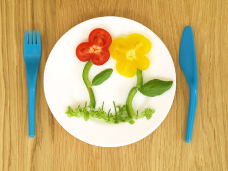 bird eye view: Healthy and appetizing vegetables for children, bird eye view Stock Photo