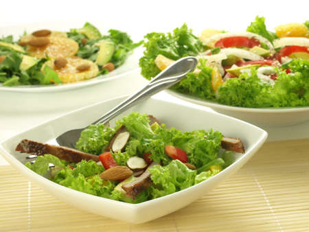 Three bowls with dietaly light salads with lettuce and vegetables Stock Photo - 14464284