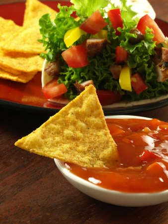 Tortilla wrap with crispy nachos with sauce photo