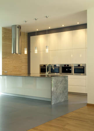 New, modern and bright kitchen with lighting photo