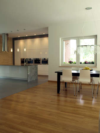 Well designed bright kitchen and dining room photo
