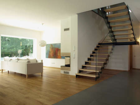 Contemporary house: staircase and a living room Stock fotó