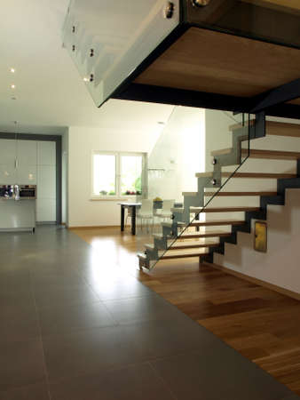 Interior of new modern house, stairs and kitchen photo