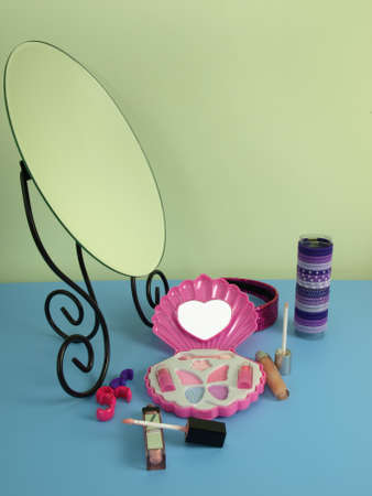 sweet stuff: Mirror and cosmetics on a blue table