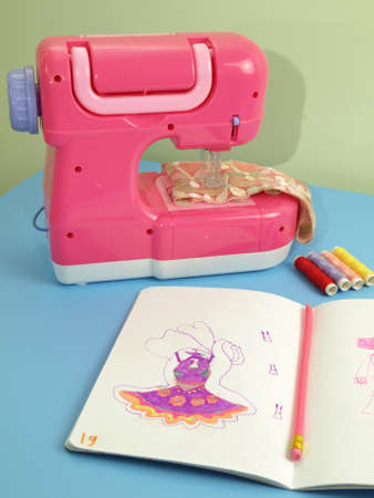 Pink sewing machine on a blue table photo