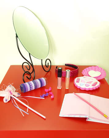 Beautiful girls stuff on a red table photo