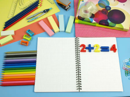 Colorful school equipment on a blue desk photo