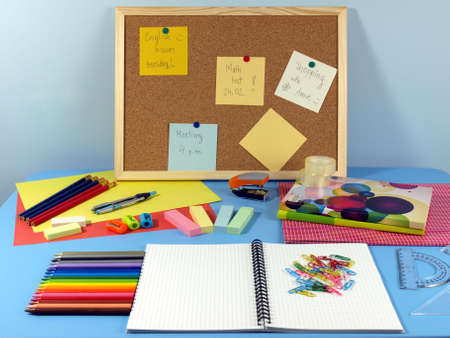 Blue table in office with colorful equipment Stock Photo - 14600869