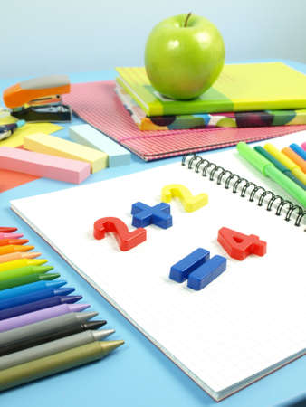 First homework,plastic numbers in the note Stock Photo - 14600871