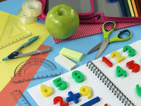 child studying: First math tasks, colorful children work place