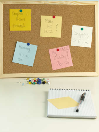 tacks: Colorful remind cards on a pin board Stock Photo