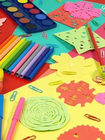 Colorful craft equipment on a children table photo