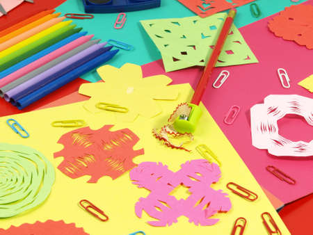 Sweet paper cut on children colorful desk photo