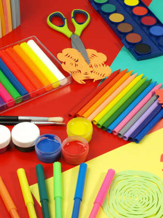 Children desk with a colorful office equipment Stock Photo - 14600918