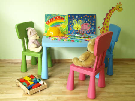 Colorful toys and crayons on blue kids table photo