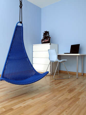 Blue original swing in teen boy room Stock Photo - 14608640