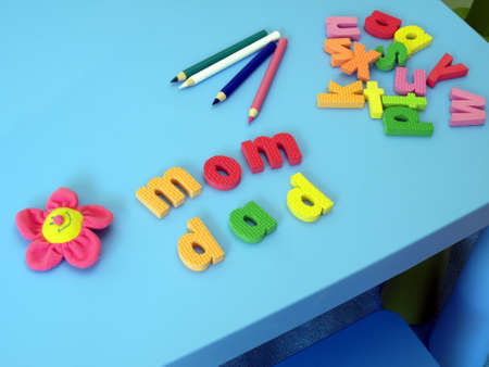 Mom and dad made with colorful letters photo