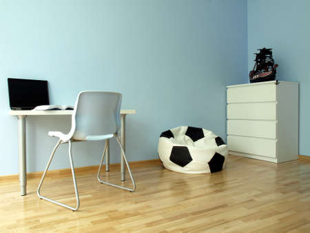 Modern blue teen room with a ball chair photo