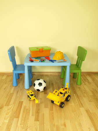 wooden toy: Plastic set of toys for a boy Stock Photo