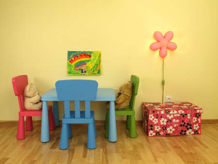 Toys at the table in childrens room photo