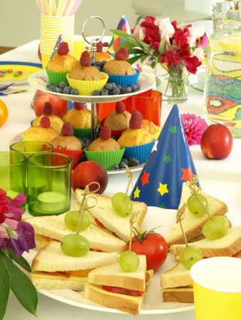 Tasty sandwiches and muffins for children's birthday photo