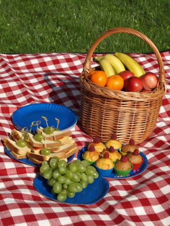 apples basket: Summer picnic on fresh air, fruits and sandwiches Stock Photo