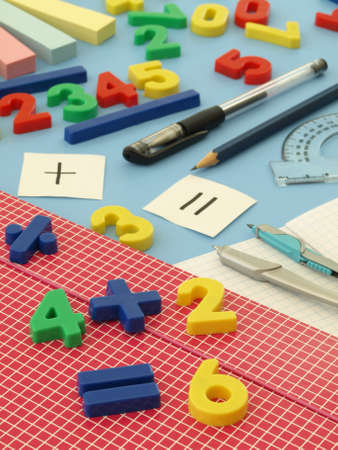 Closeup of colorful plastic numbers on blue table photo