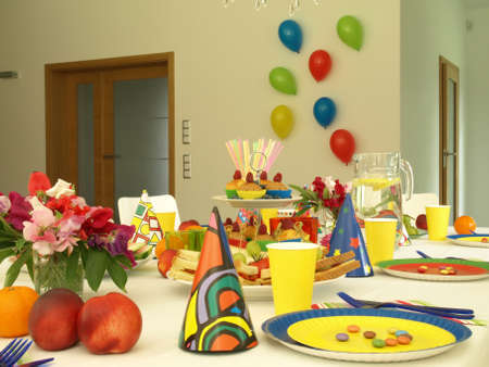 Colorful paper cutlery on childrens table,balloons photo